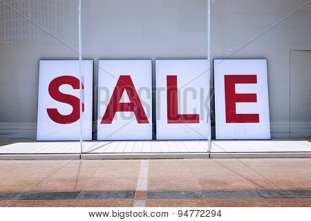 sale poster in shop display window