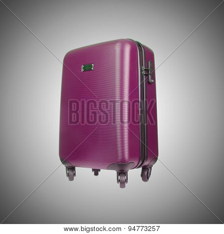 Travel luggage against the gradient background