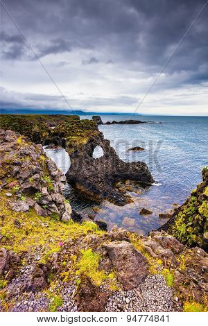 Magical coastal cliffs fishing village Arnastapi. July day in Iceland