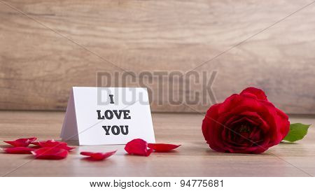 I Love You Card With Red Rose On The Table