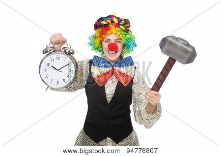 Female clown with alarm-clock and hammer isolated on white