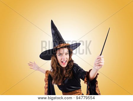 Witch with wand against the gradient