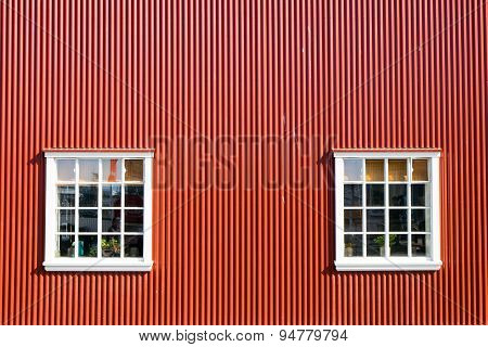 Red wall and two windows