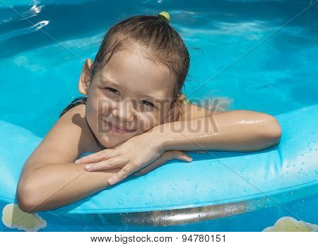 Little Girl In Inflatable Swimming Pool