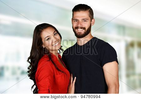 Man and woman posing together inside their home