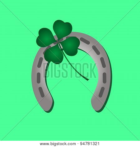 Silver Metal Horseshoe And Green Cloverleaf Eps10