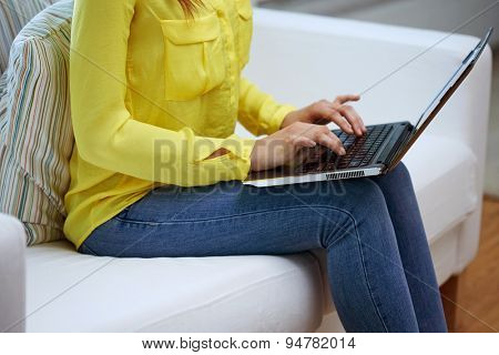 business, technology, people and education concept - close up of woman with laptop computer at home