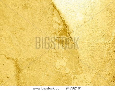 Gold background wall with cracks