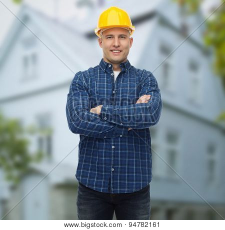 repair, construction, building, people and maintenance concept - smiling male builder or manual worker in helmet over living house background