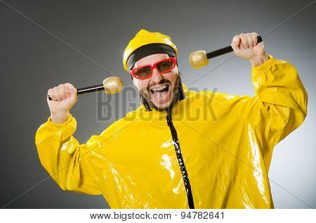 Man wearing yellow suit with mic