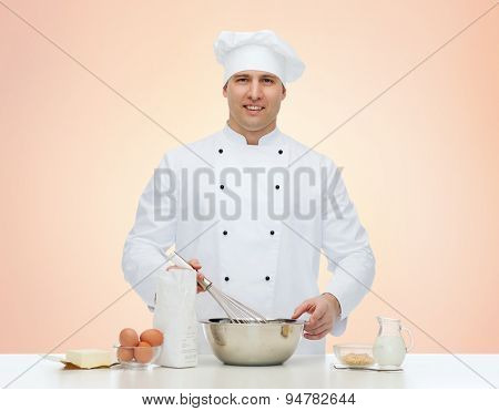cooking, profession, haute cuisine, food and people concept - happy male chef cook baking over beige background