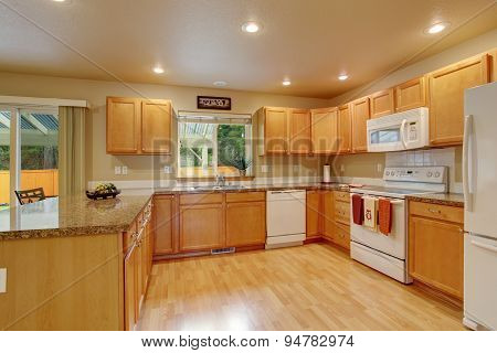 Classic Kitchen With Hardwood Floor.