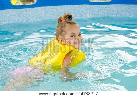 Girl Learning To Swim In The Pool