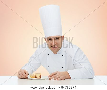cooking, profession, haute cuisine, food and people concept - happy male chef cook with dessert over beige background