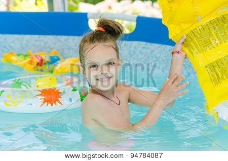 Six Year Old Girl Bathing In Pool