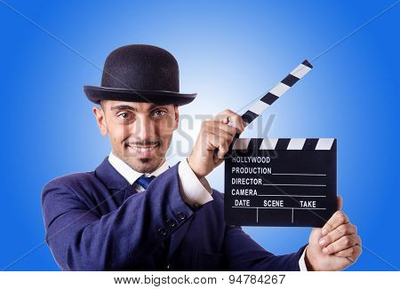 Man with movie clapper against the gradient