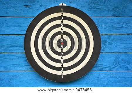 Target Dartboard On Old Blue Wooden Plank With No Hits