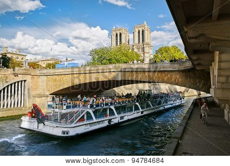 People Ride On A Pleasure Boat On The River Seine
