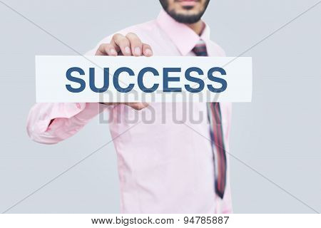 Holding a success note