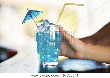 Closeup of a woman taking a cocktail