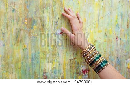 Woman Hand With Shiny Colorful Bracelets