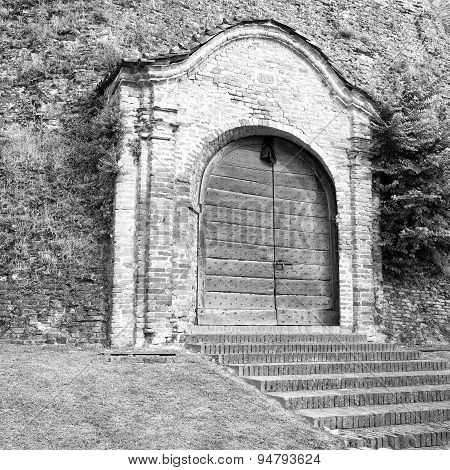 Old medieval castle gate. Black and white photo