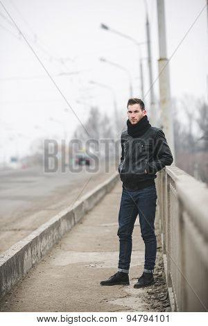 The man in the authentic boots and jeans