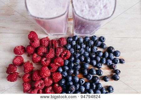 Raspberry And Blueberry Smoothie With Fresh Berries On Wood Table