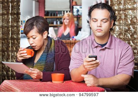 Distracted Couple Using Devices