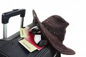 pic of boarding pass  - Suitcase with hat, two passport and boarding pass on it isolated against a white background. Travel concept