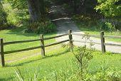 foto of dirt road  - Wooden Fence beside a dirt road in Brattleboro - JPG