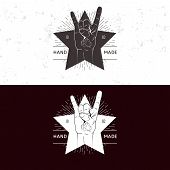 Retro vintage badge, symbol or logotype with hand. For design elements, business signs, logos, ident poster