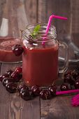 stock photo of cherries  - homemade cherries drink with fresh cherry on wooden table - JPG