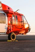 foto of military helicopter  - Orange military helicopter at the airport closeup - JPG