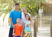 picture of amusement  - Beautiful young family enjoying a day at an outdoors amusement park - JPG