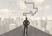 image of solution  - Businessman looking at road with maze and solution concept - JPG