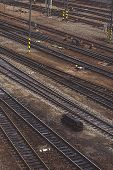 image of railroad yard  - Aerial Top View of Intersecting Rails at Train Railway Station - JPG