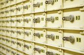 pic of bank vault  - Closeup of a group of cells in an old safe bank - JPG