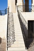 stock photo of battle  - Steps with railings and shadows leading to Maltese war memorial in commemmoration of battle for malta - JPG