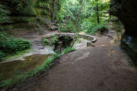 picture of ravines  - Stone footbridge crosses over a ravine dubbed the Devils Bathtub - JPG