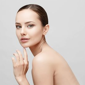 stock photo of cleanse  - Beautiful Face of Young Woman with Clean Fresh Skin close up isolated on white - JPG