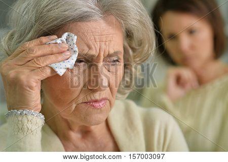 Portrait of sad senior woman with handkerchief