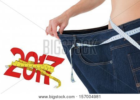 Woman waist who lost a lot of weight against digitally generated image of new year with tape measure