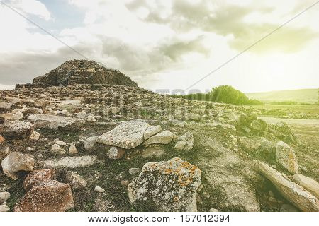 Ruins of ancient city in prehistorical time located in Barumini - Nuraghe culture is a 1500 a.c civilization - Concept of visiting italian's old stronghold and ruins - Vintage retro filter