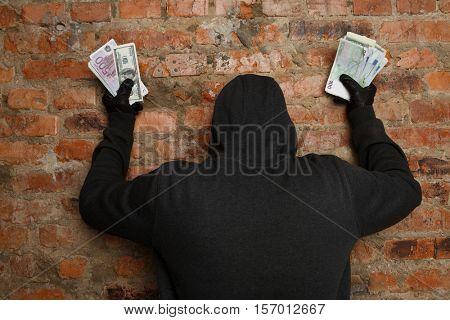 Cracker with money in hand