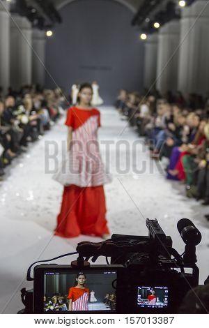 KYIV, UKRAINE - OCTOBER 13, 2016: Televison camera broadcasting a show during the 39th Ukrainian Fashion Week at Mystetsky Arsenal in Kyiv