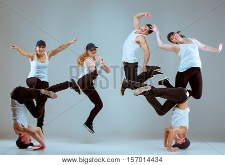 Group of men and women dancing fitness or hip hop ...
