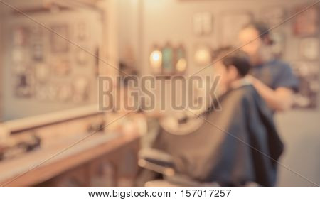 Blur Image Of Young Asia Boy At Barber Shop.