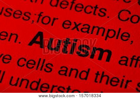 Newspaper article with detailed word AUTISM, closeup