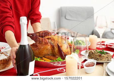 Woman serving table for Thanksgiving dinner, close up view